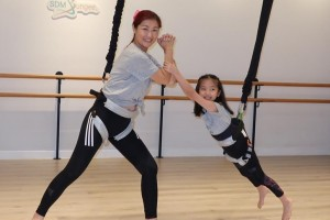 June Chan tries Bungee Dancing with Daughter